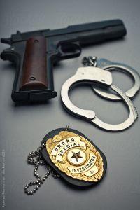 Badge, Gun and Handcuffs